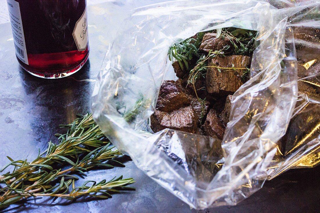 Slow-roast boeuf bourguignon in a plastic bag