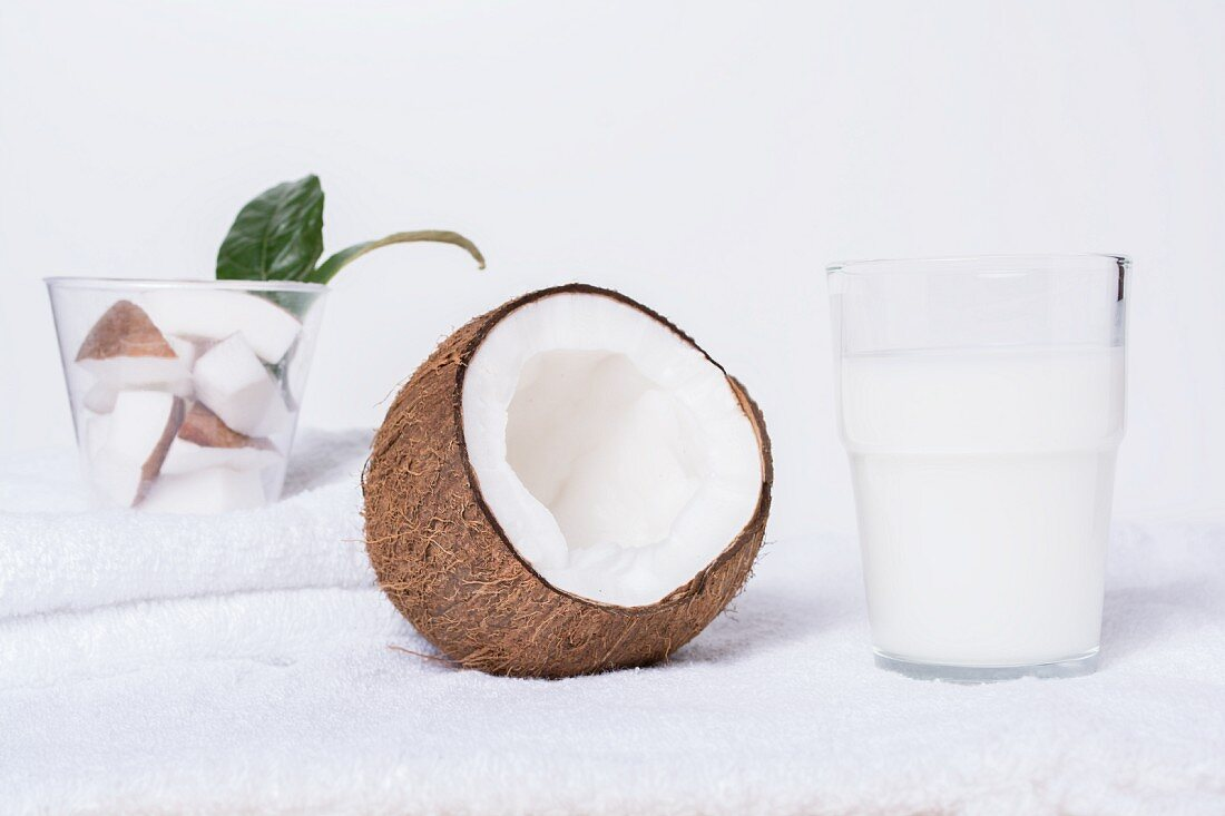 Coconut milk and an open coconut