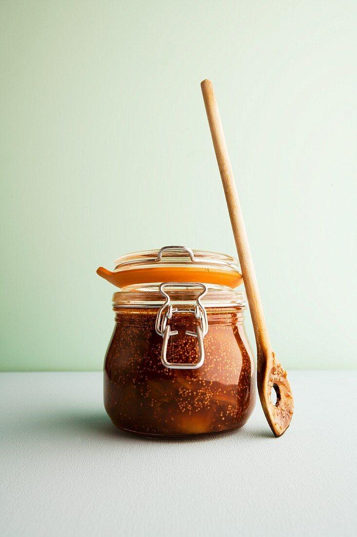 Dried fig chutney with honey in a flip-top jar
