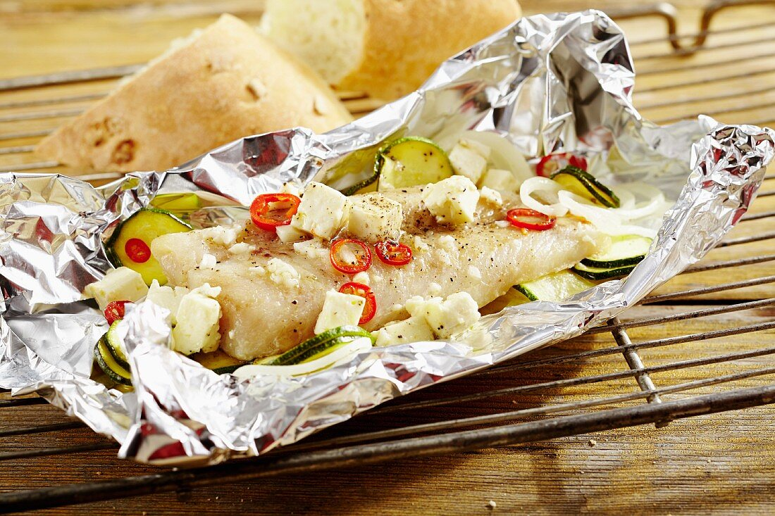 Hake fillets wrapped in foil with courgettes and sheep's cheese (Cyprus)