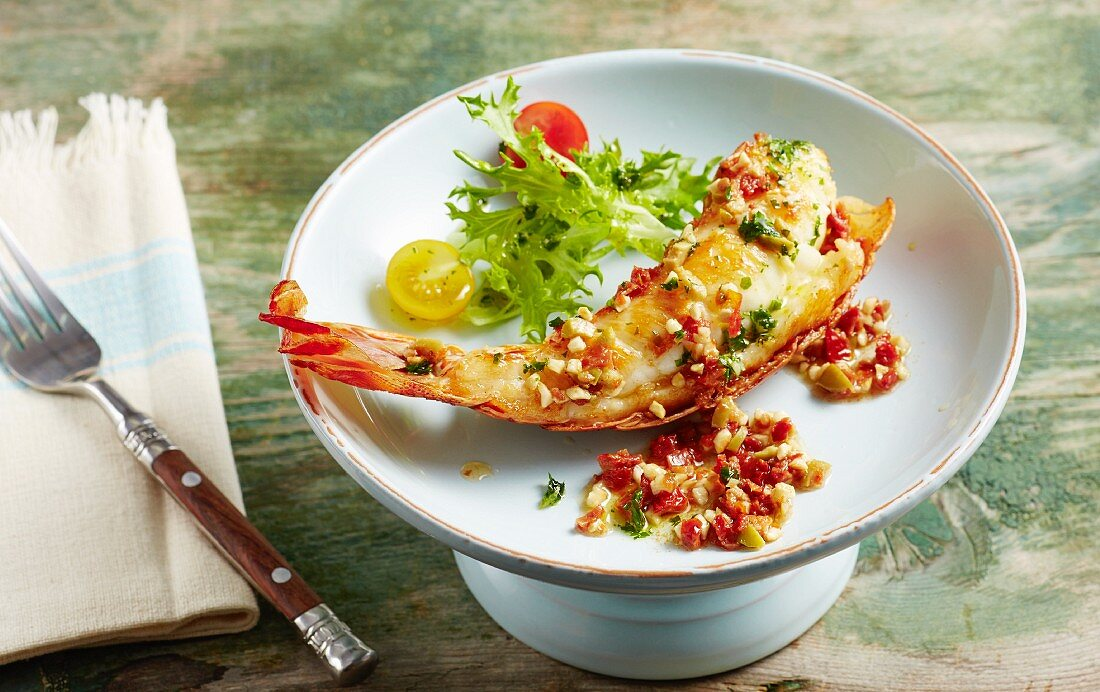 Fried langoustine tail with an almond vinaigrette