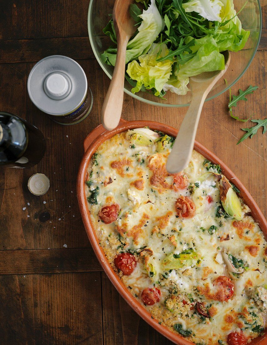 Quinoa and spinach bake with cocktail tomatoes