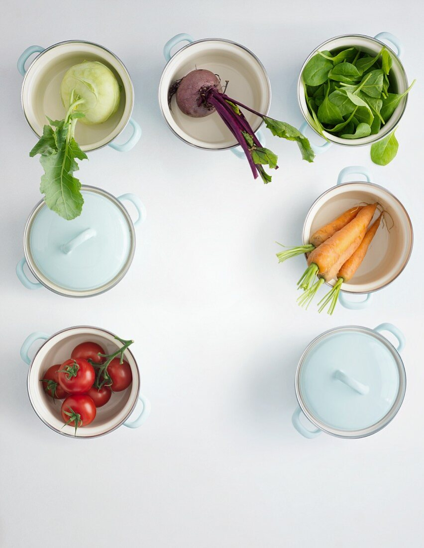 Various basic ingredients for creamy vegetable soups in pots