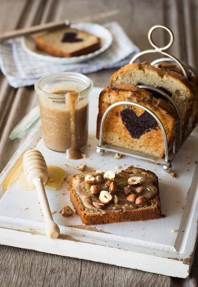 Banana bread with homemade hazelnut butter and honey