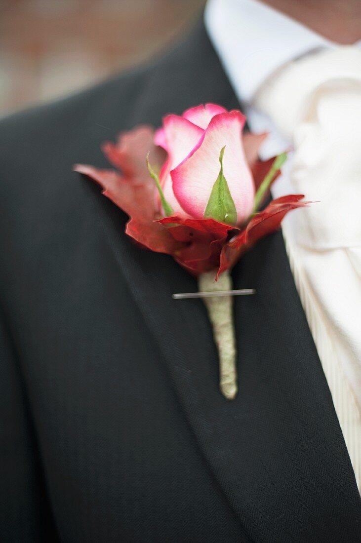Rose buttonhole on groom's lapel