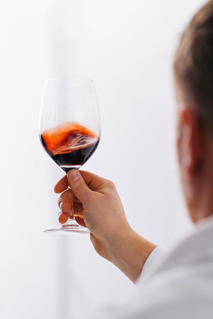 Swirling red wine in glass