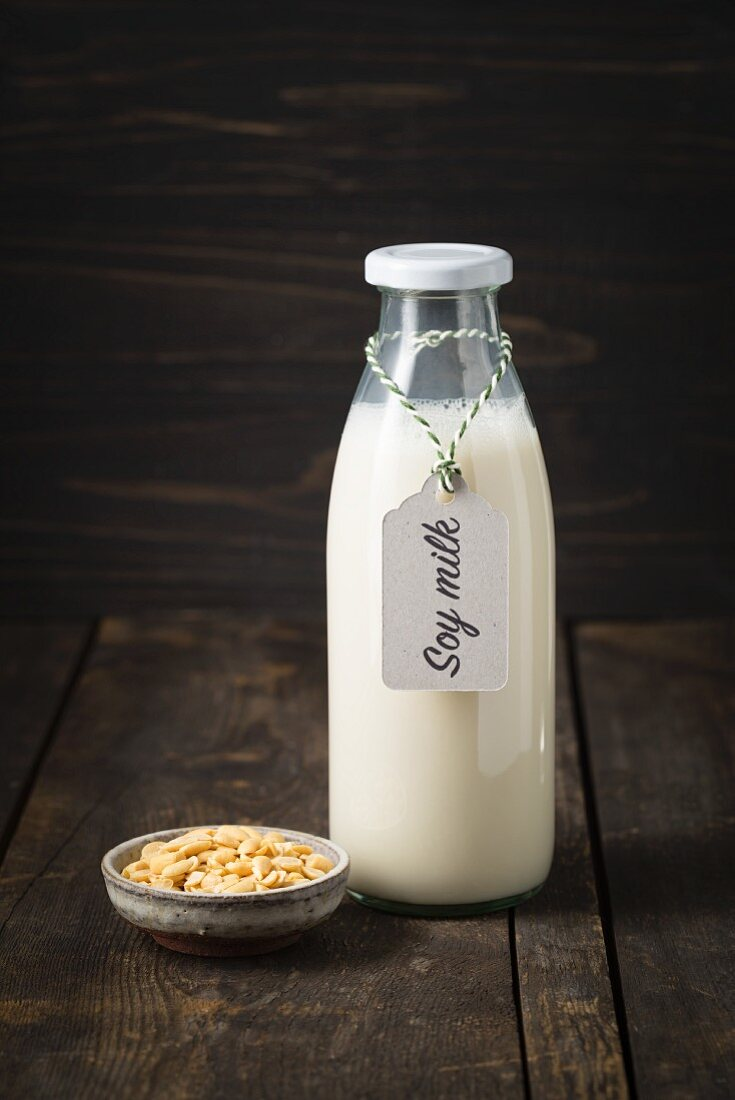 Soya milk in a glass bottle with a label