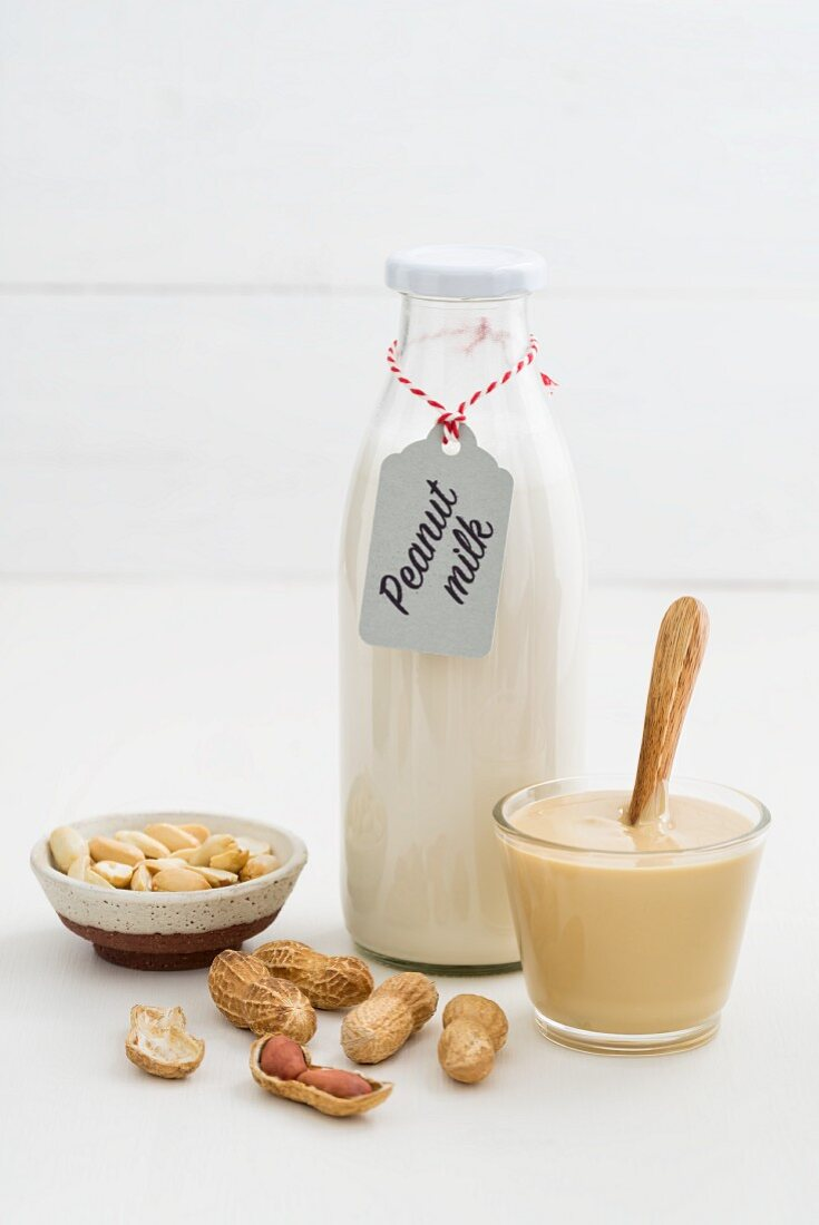 A jar of peanut mousse and peanut milk in a glass bottle
