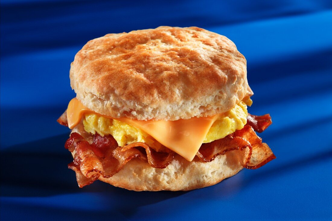 Bacon, scrambled eggs and cheese on an American biscuit