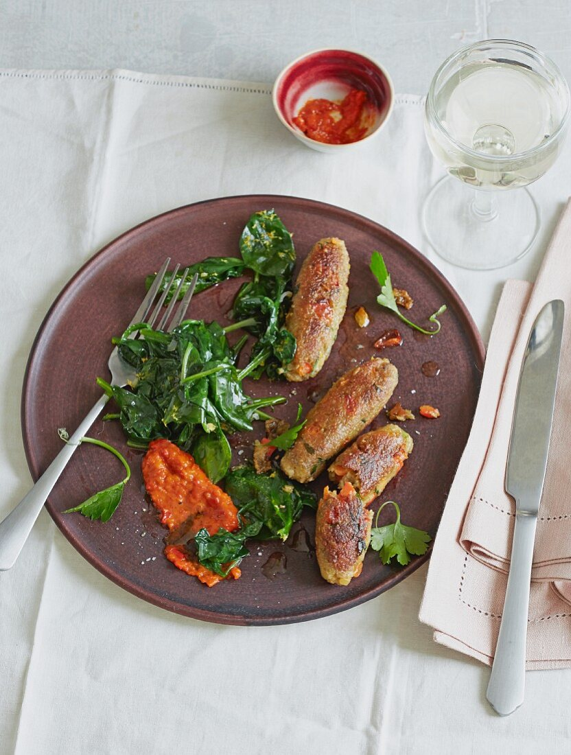 Cevapcici made from unripe spelt grains with spinach and ajvar