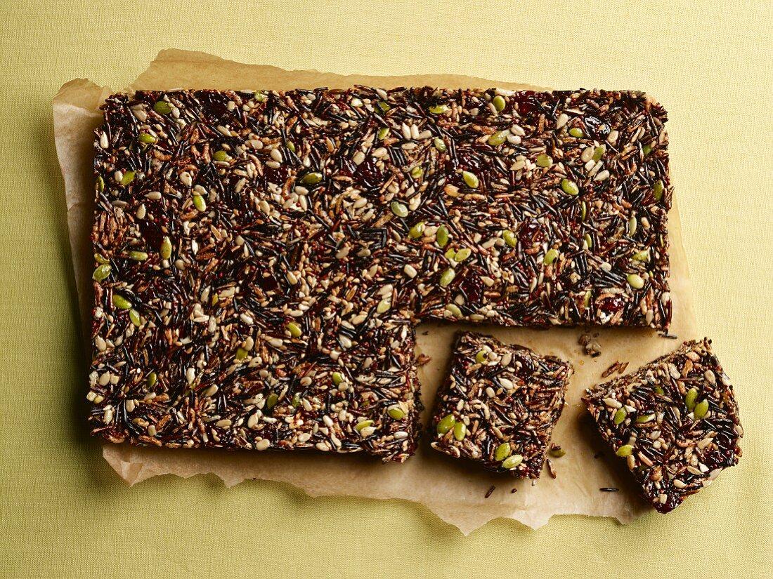 Homemade muesli bars with quinoa, seeds, wild rice and chocolate