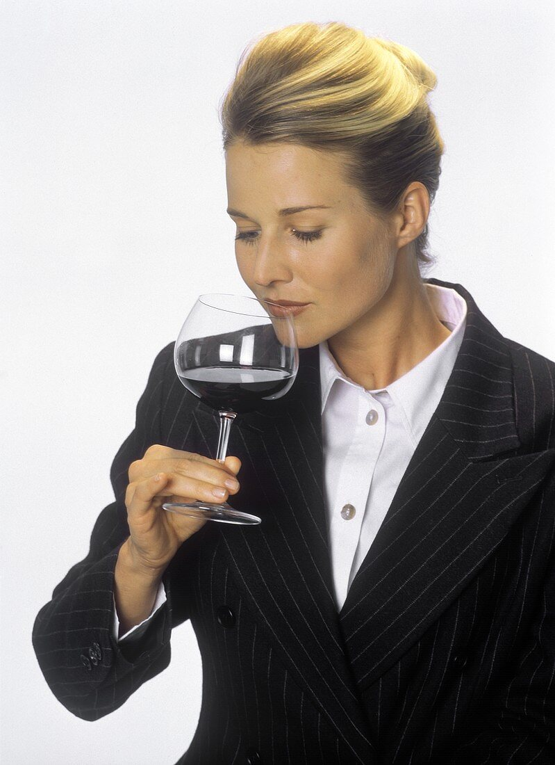 A Woman Testing a Glass of Red Wine