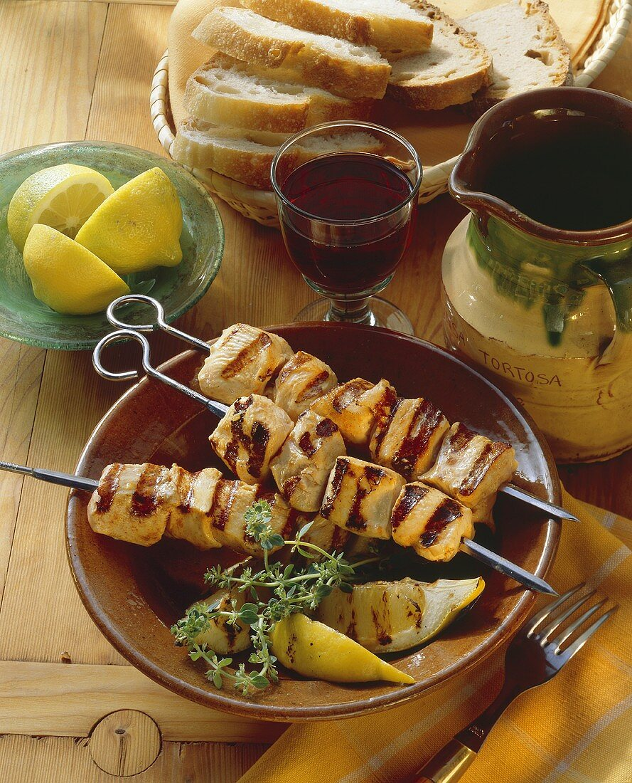 Three kebabs with marinated and grilled chicken