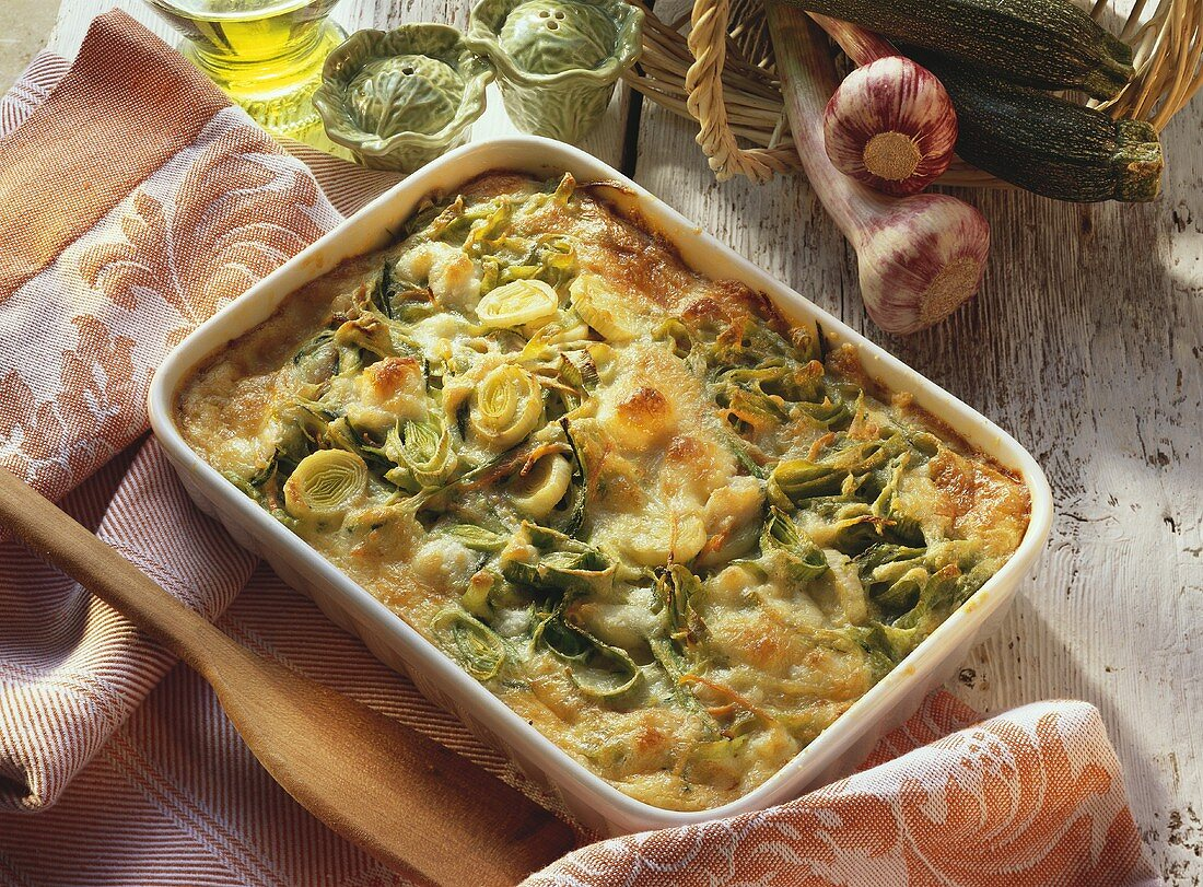 Vegetable bake with green ribbon noodles in casserole dish