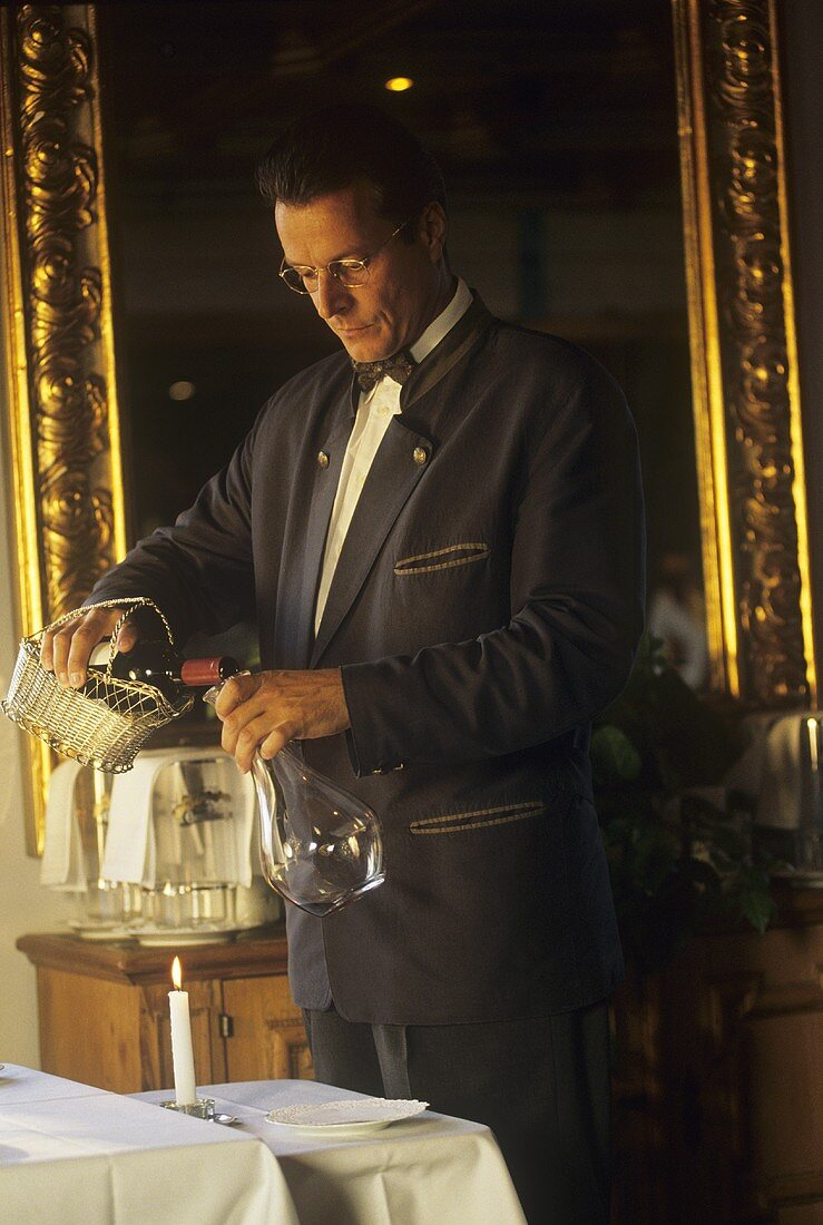 A Waiter Decanting Red Wine