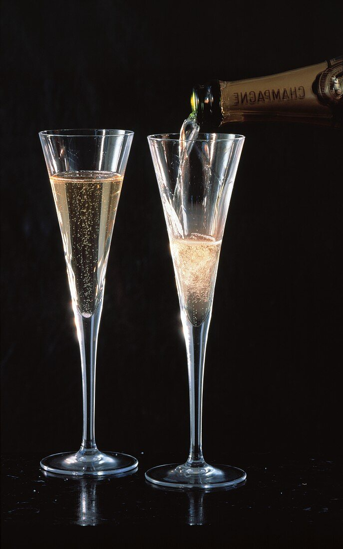 Champagne being poured into a champagne flute