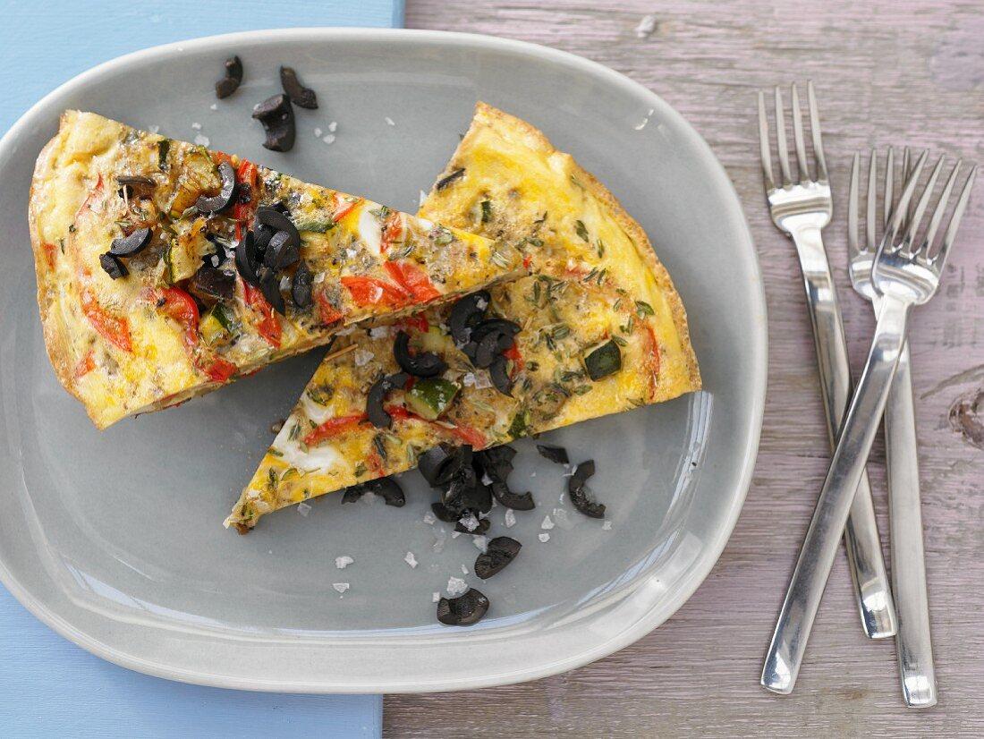 Vegetable omelette with black olives