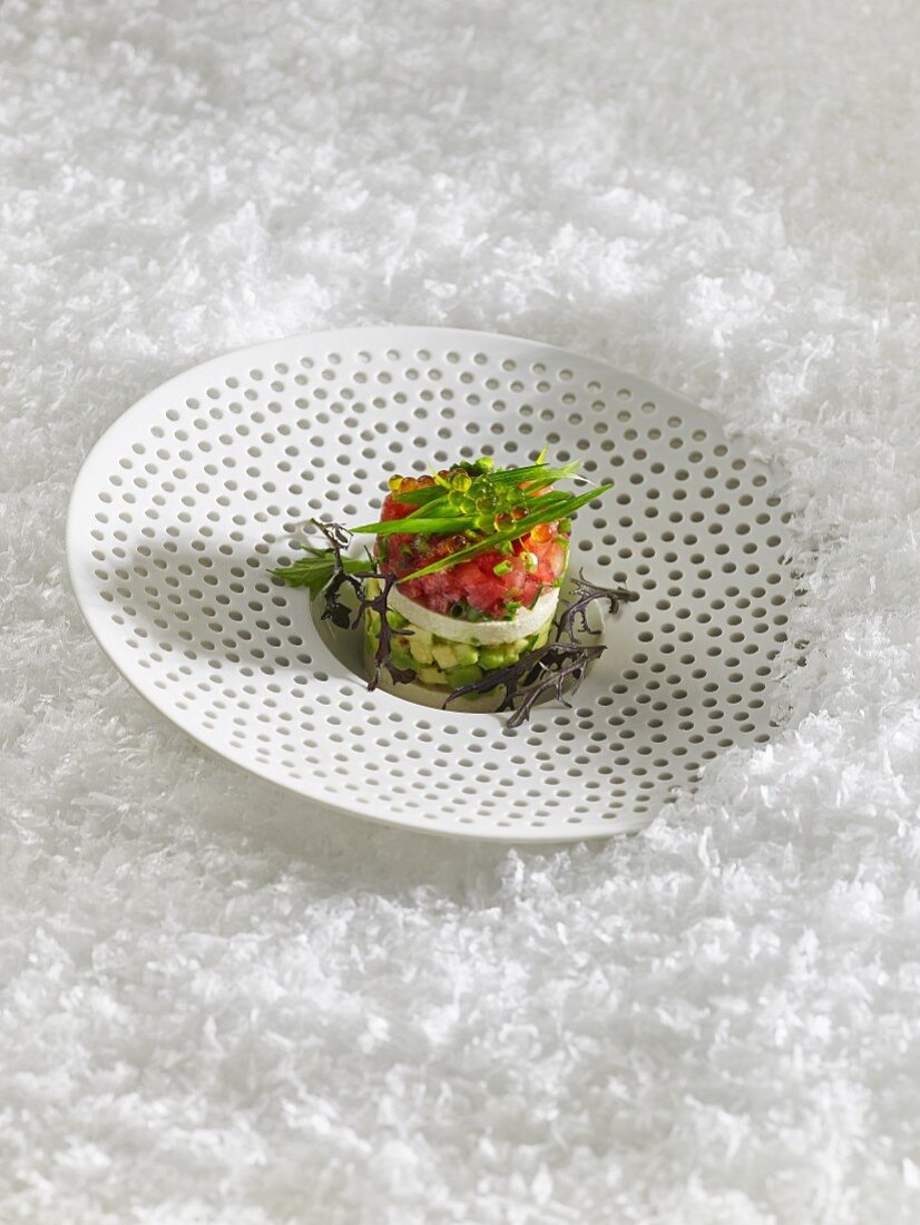 Avocado tartare with tomatoes for Christmas