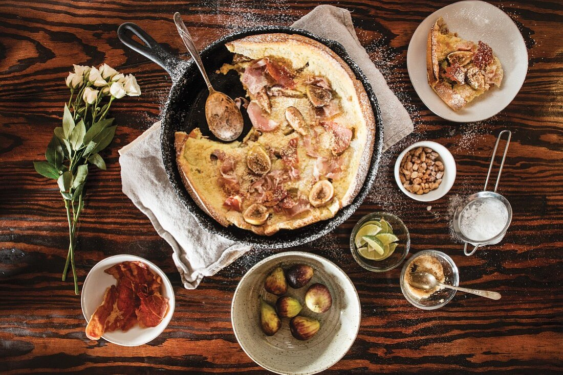 An omlette with roasted figs, country ham and spicy peanuts