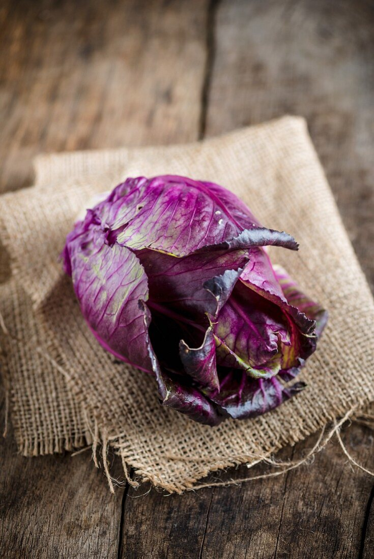 A red cabbage on a piece of hessian cloth