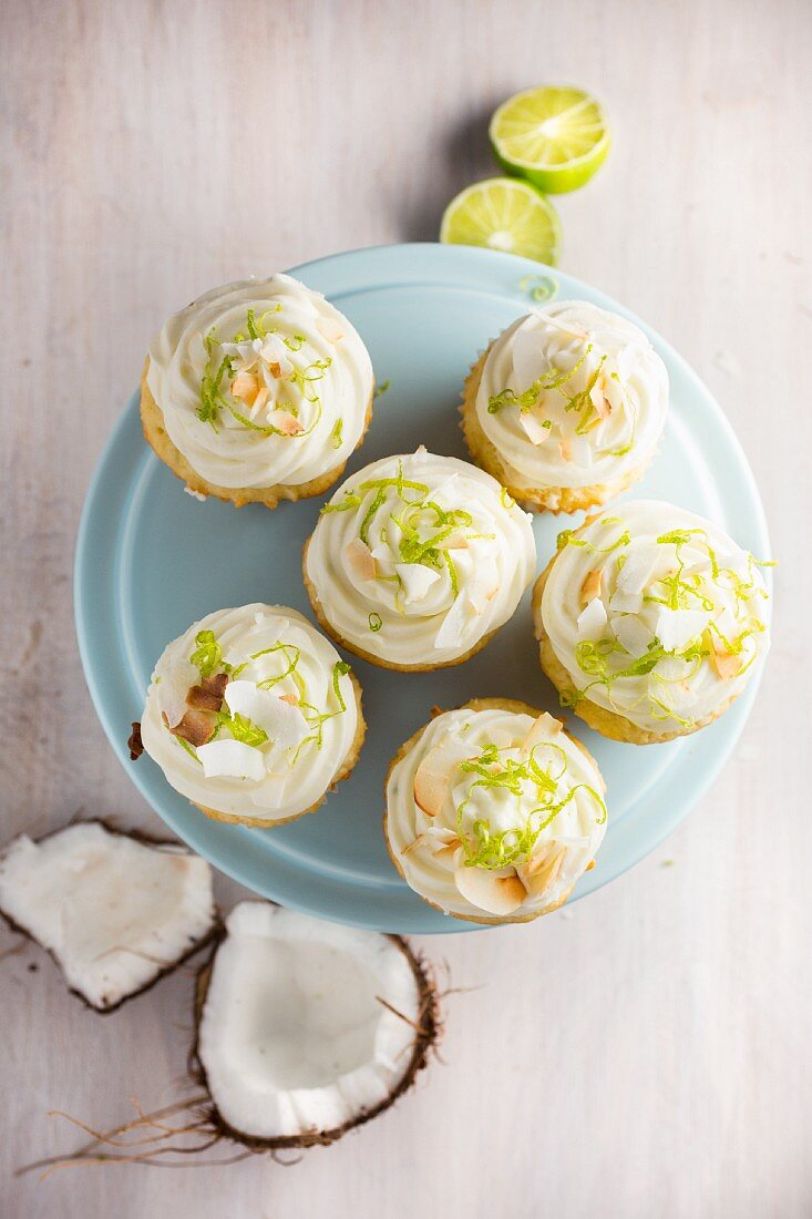 Lime and coconut cupcakes on a cake stand