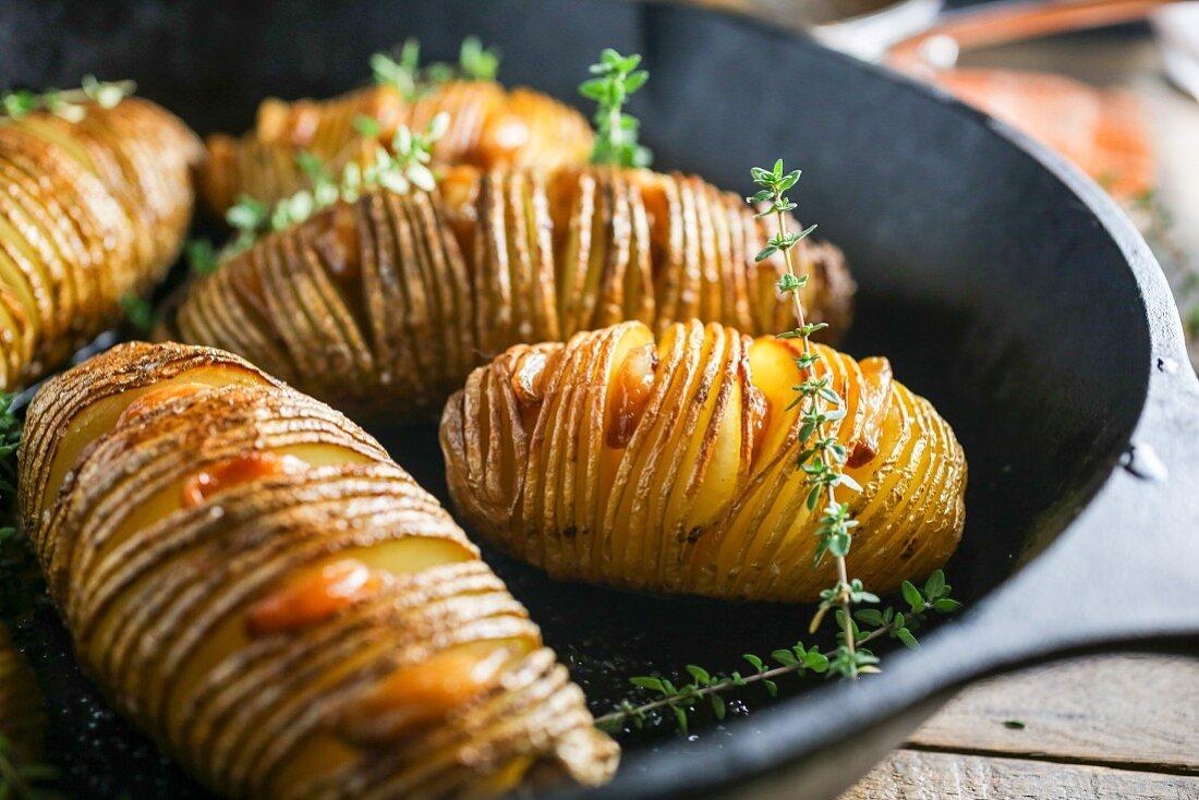Hasselback potatoes in a frying pan