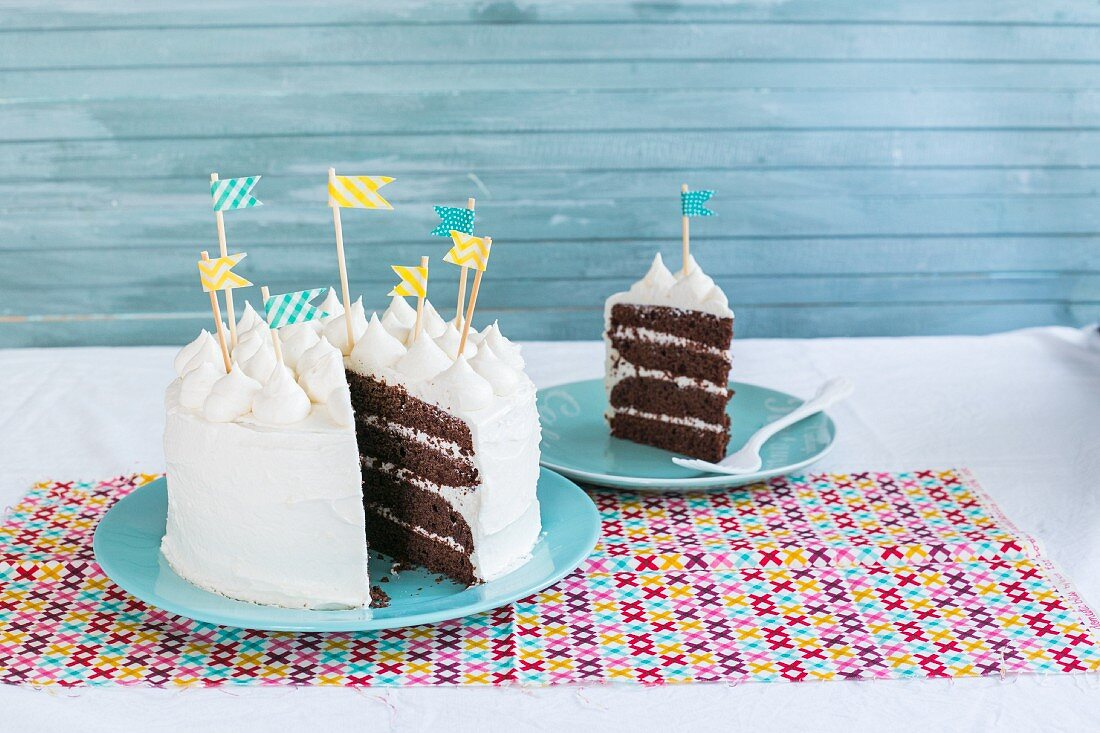 A chocolate birthday cake with cream cheese frosting