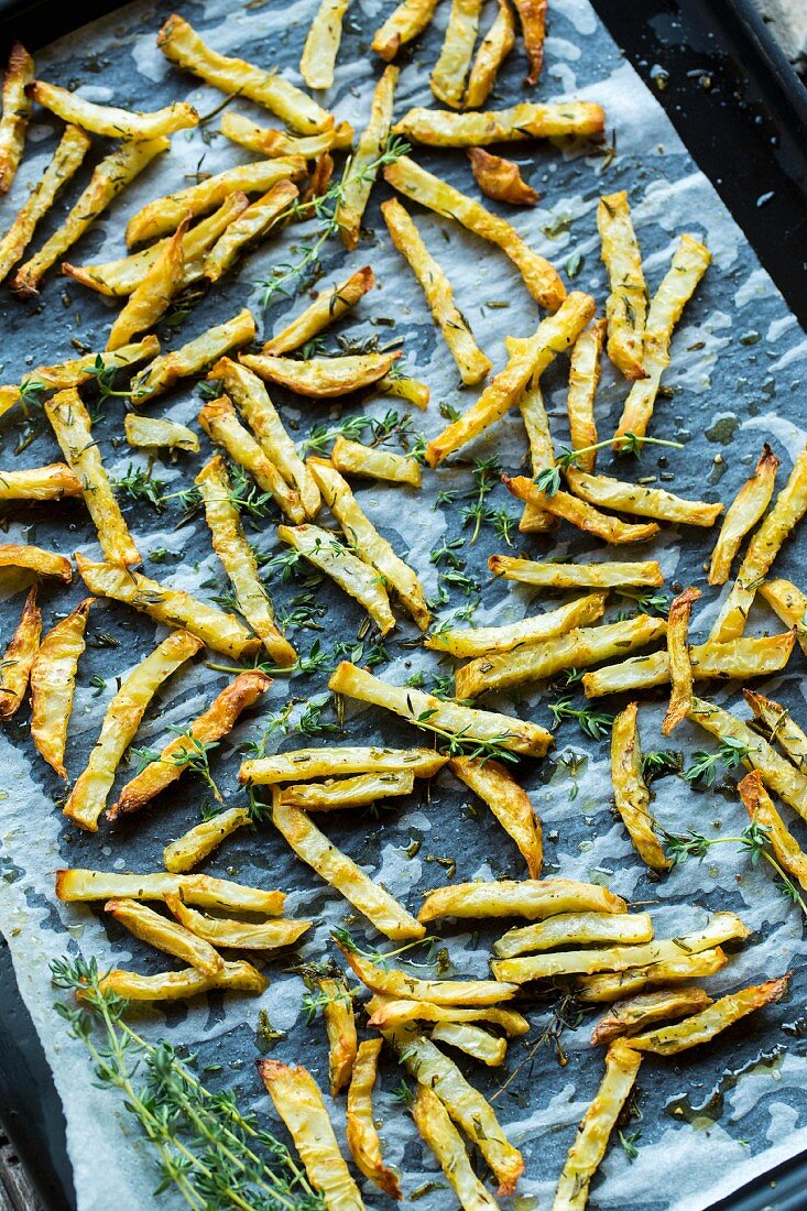 Baked celeriac chips on an oven tray