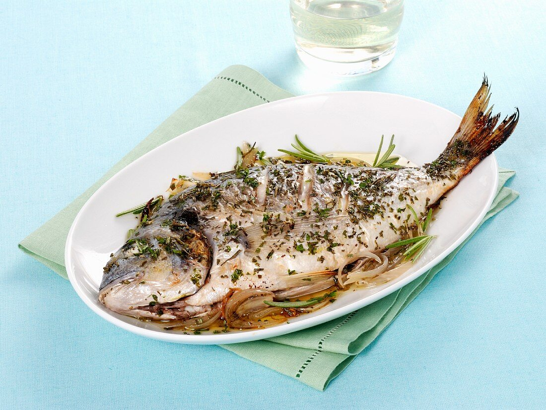 Pan-fried gilt-head bream with garlic and rosemary