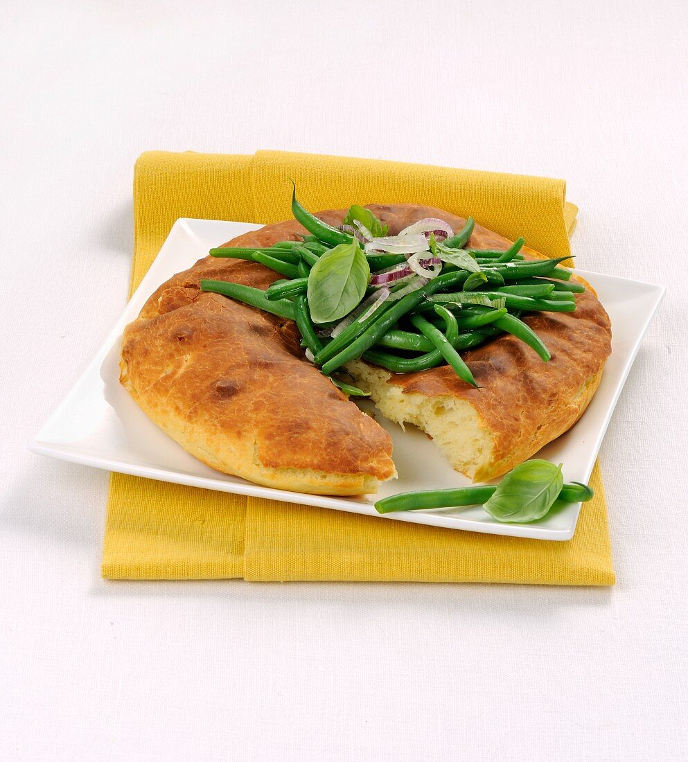 Italian schiacciata with ricotta, green beans and basil