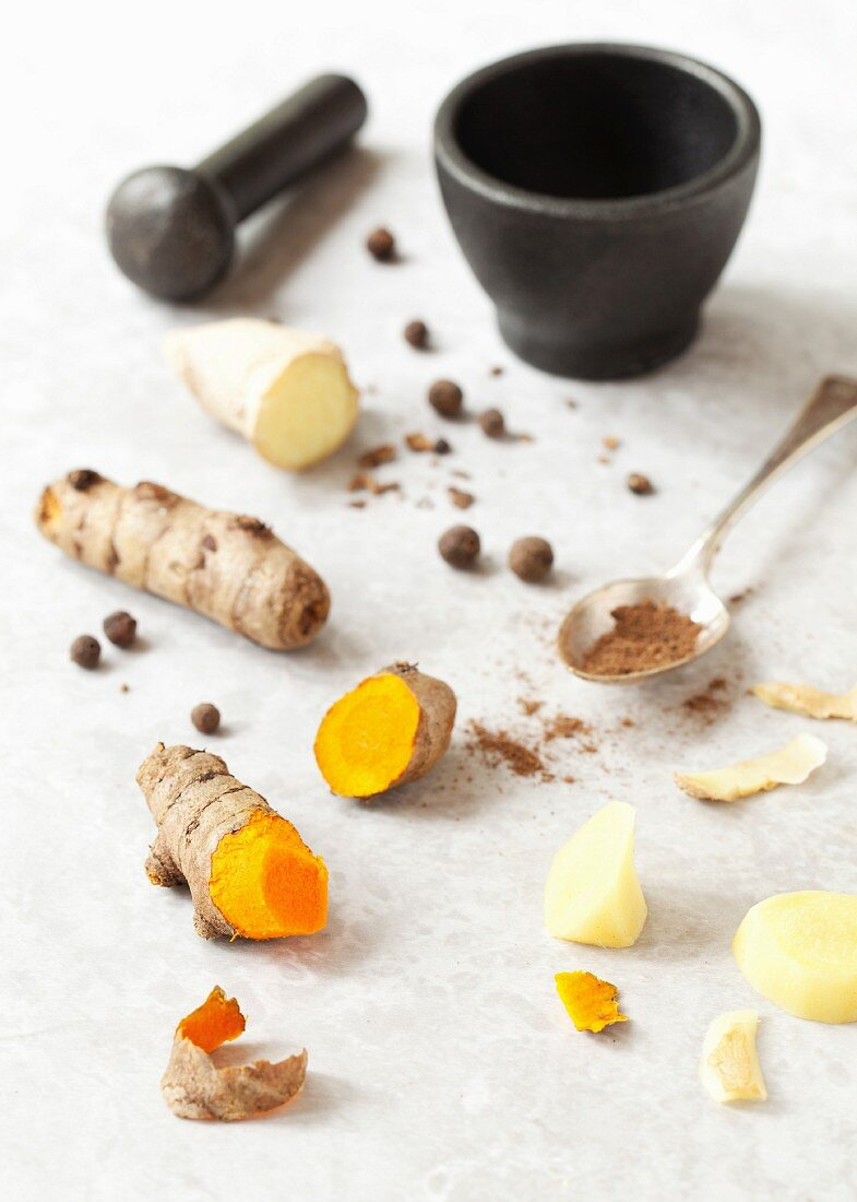 Fresh turmeric root, ginger root and allspice