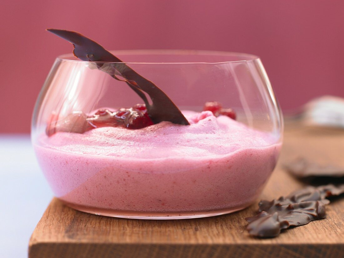 Lingonberry yoghurt espuma with almonds in chocolate
