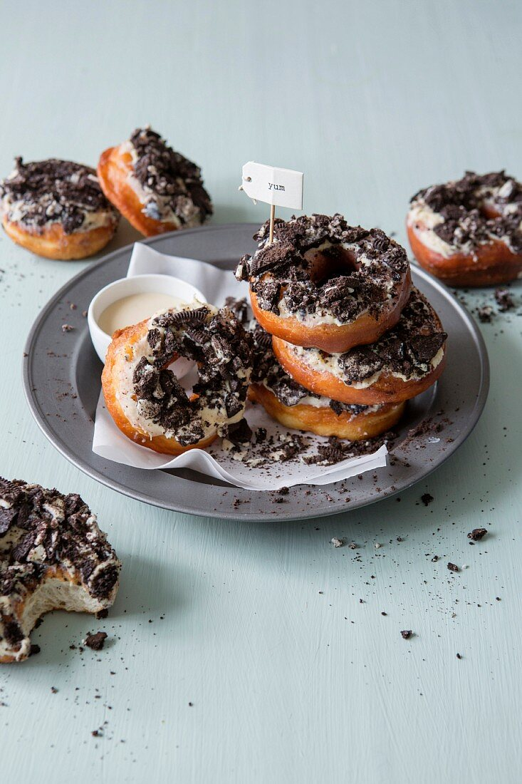 Doughnuts with white chocolate icing and Oreo biscuits