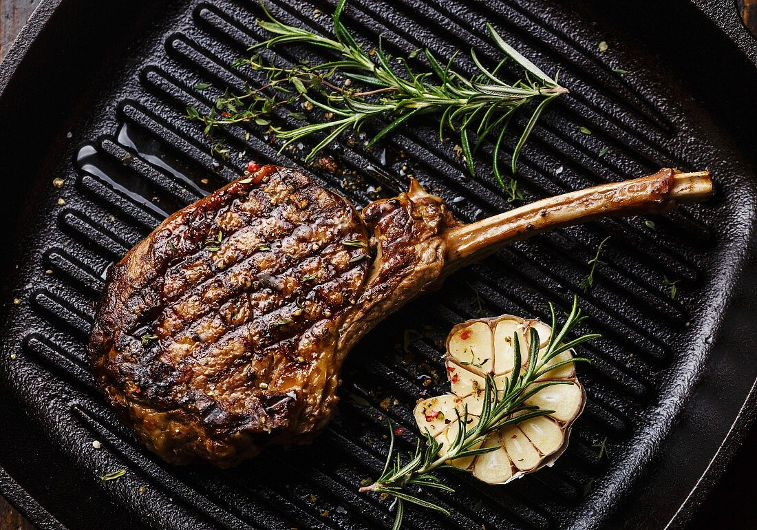 Grilled beef barbecue Veal rib on frying cast iron Grill pan