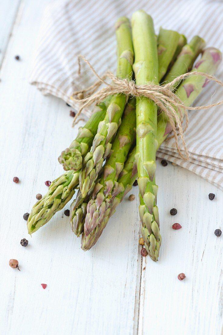 A bunch of green asparagus on a cloth