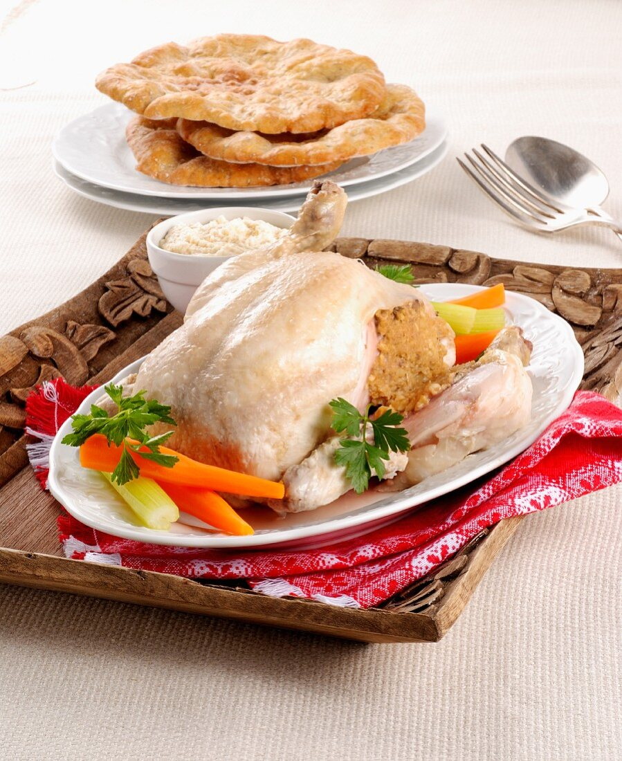 A chicken stuffed with pine nuts and walnuts