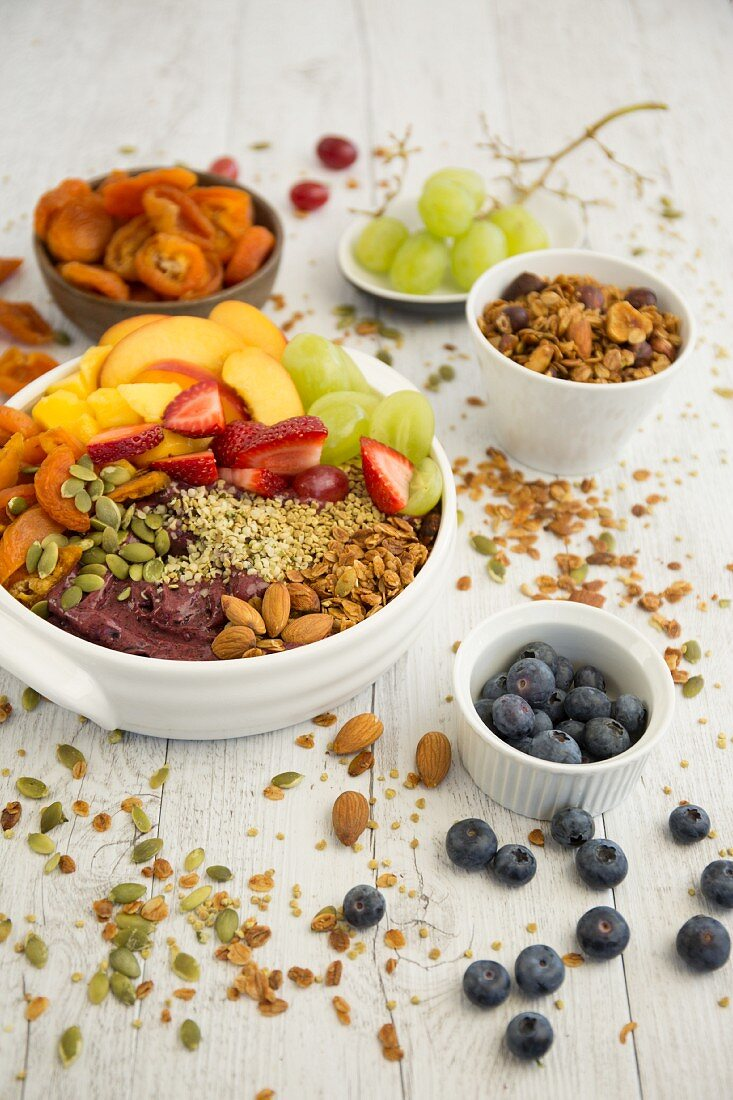 A smoothie bowl with acai berries, almonds and fruits
