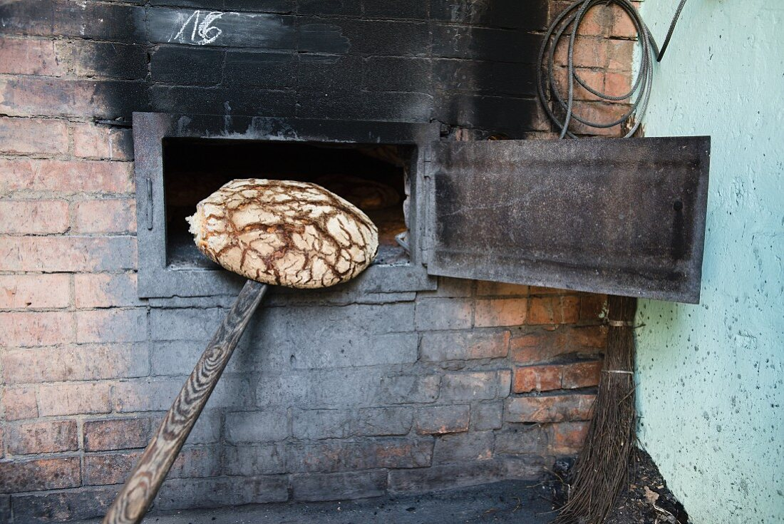 Rye bread (made with sour dough) being taken out of the oven