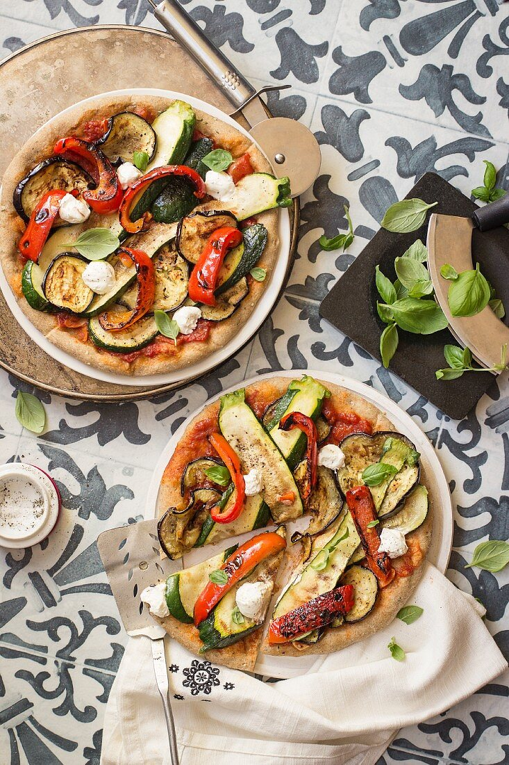 Wholemeal pizzas with grilled vegetables, labneh and basil