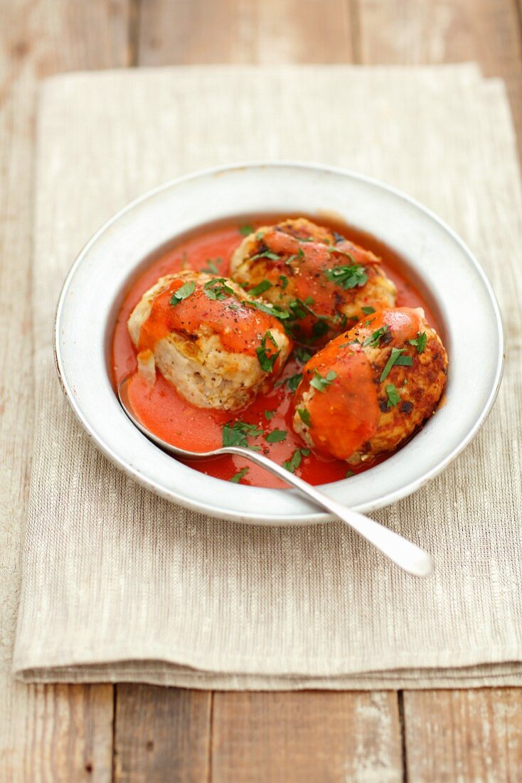 Pork meatballs with cabbage and rice in tomato sauce