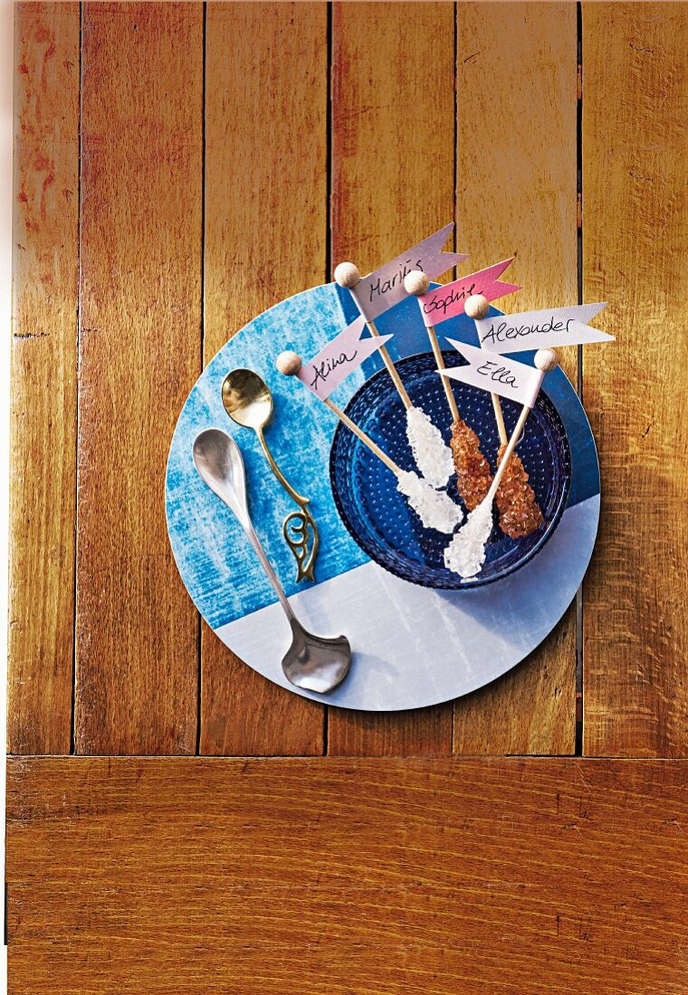 Accessories for the tea table set in East Friesian style: blue crockery, a silver spoon and sugar dippers