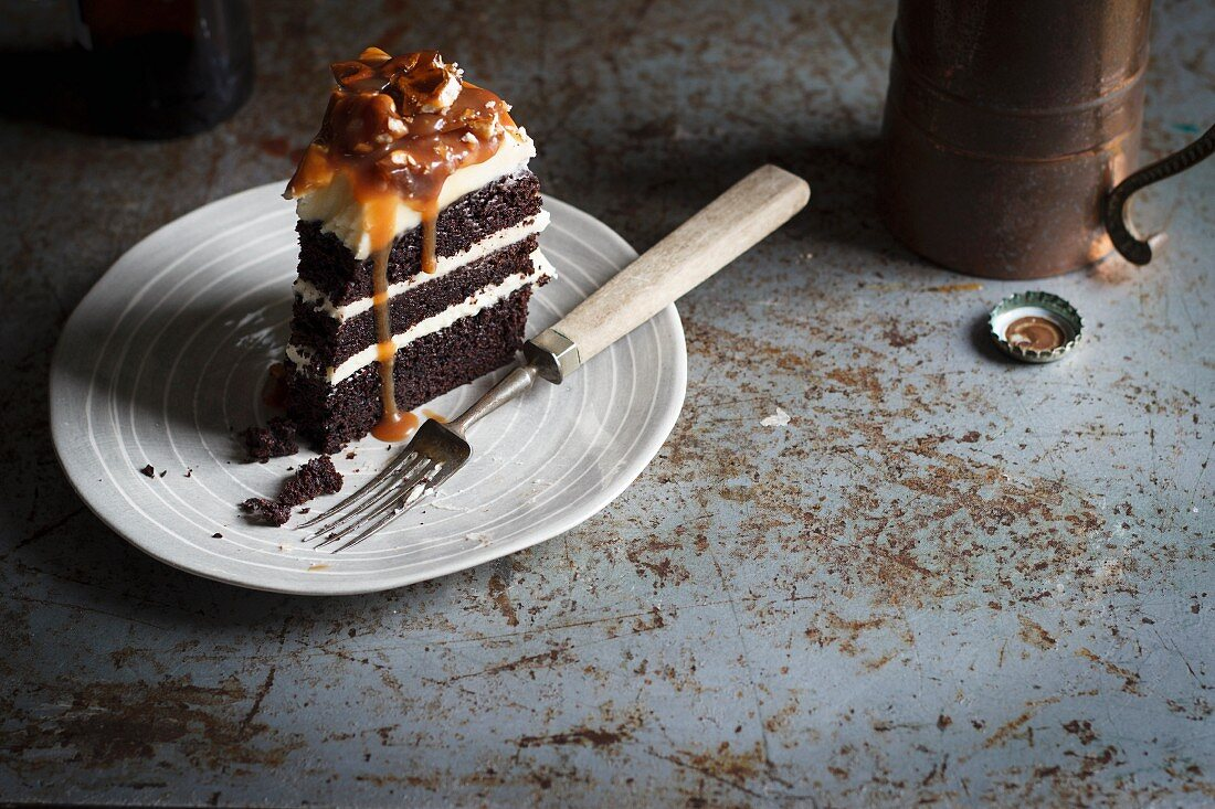 A slice of chocolate and stout cake with pretzels