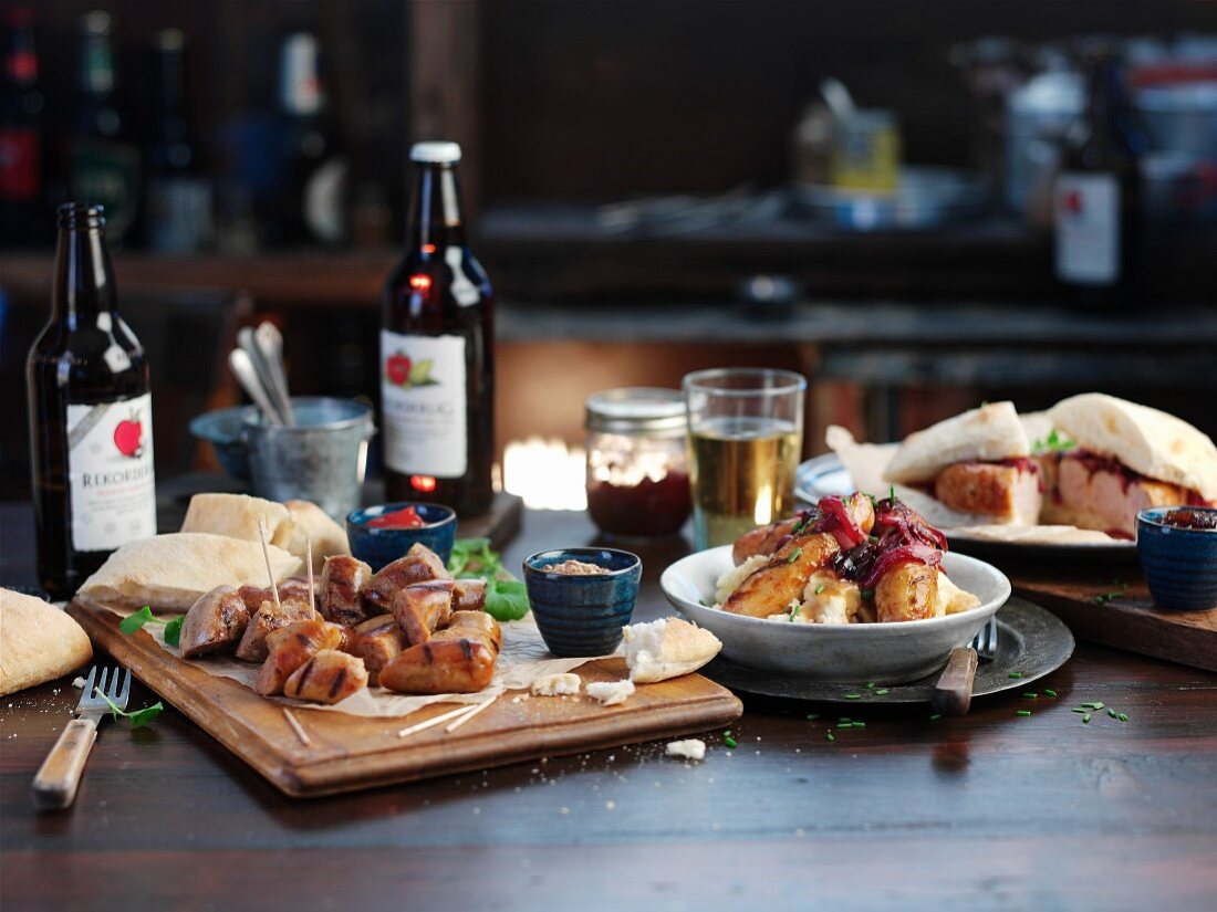 Assorted sausage dishes with beer