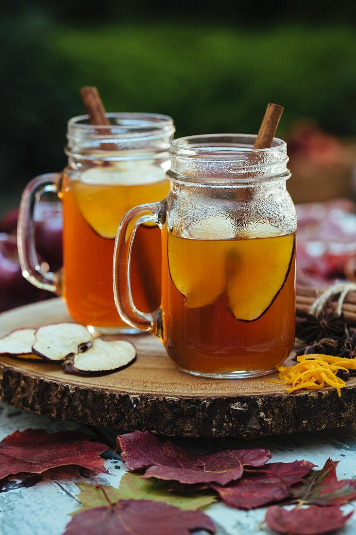 Hot mulled milled cider on an autumn table