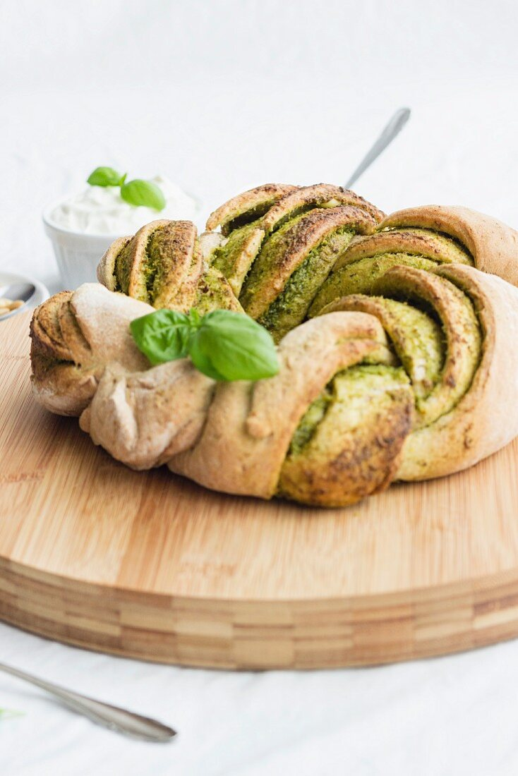 A pesto bread ring with basil
