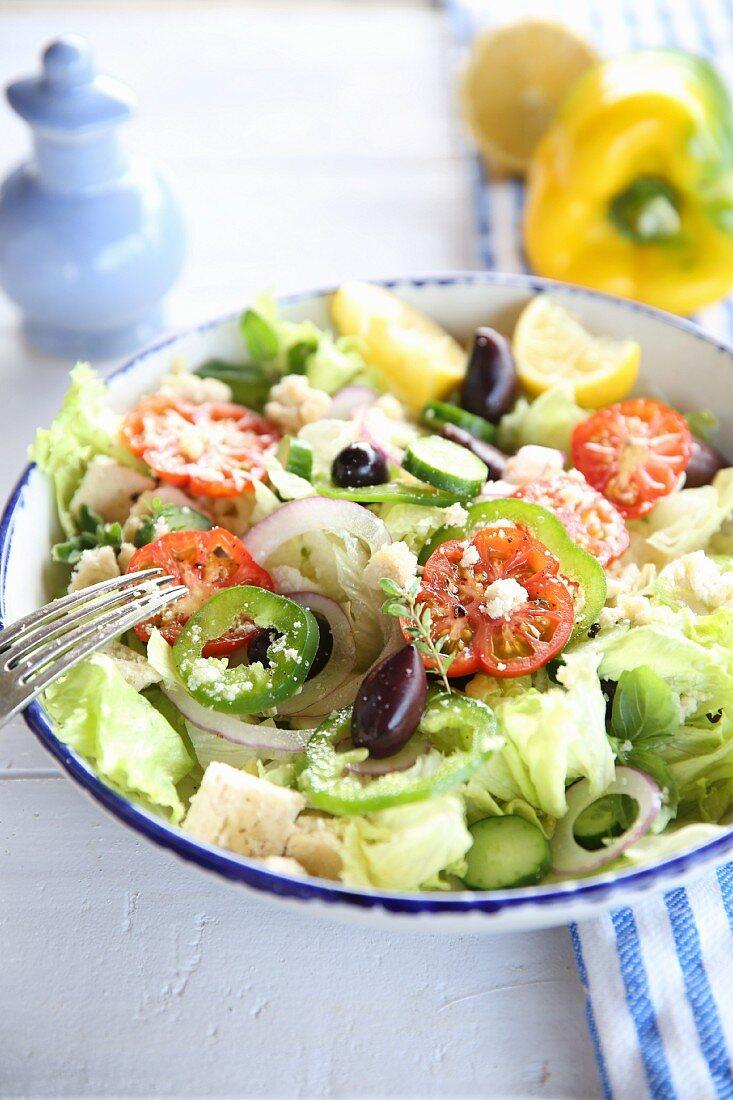 Vegan Greek salad with almond feta