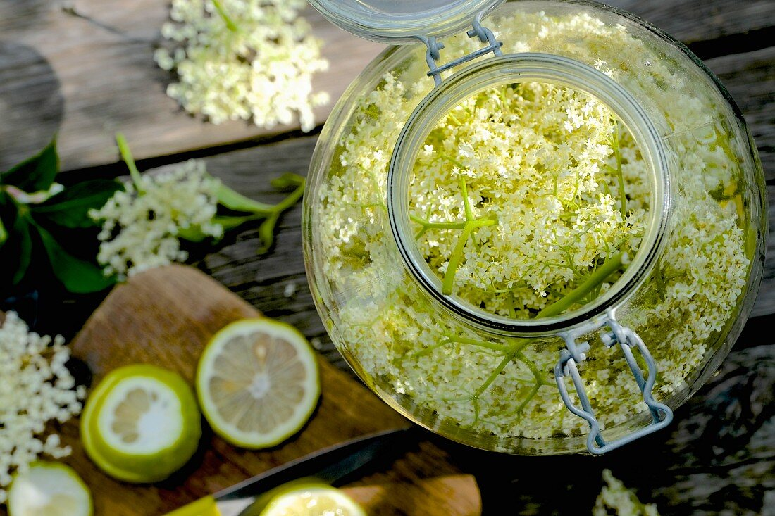Homemade elderflower syrup with lime in a flip-top glass