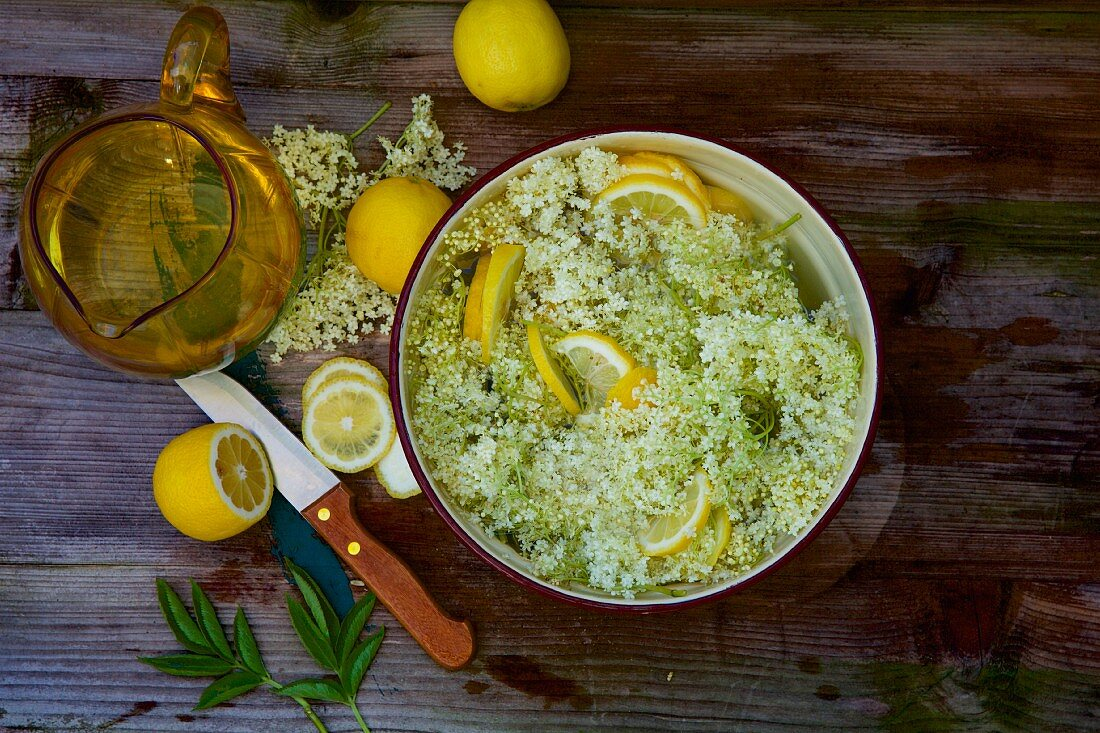Elderflower syrup being made with lemon slices