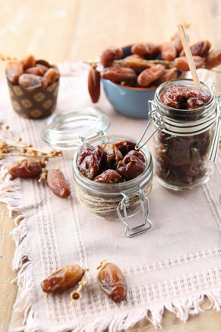 Medjool dates in different containers