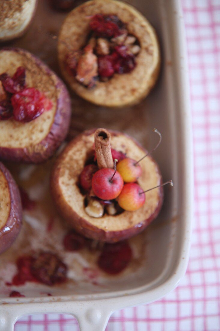 Baked apples with cinnamon sticks and crab apples